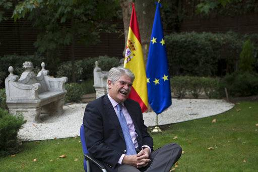 "Spain's Foreign Minister Alfonso Dastis smiles before an interview with The Associated Press about the Catalonia's referendum at the Foreign Ministry in Madrid, Spain, Saturday, Sept. 30, 2017. Dastis said Saturday the Catalan government's plan is anti-democratic and runs ""counter to the goals and ideals"" of the European Union."