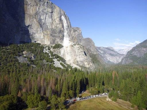 This Thursday, Sept. 28, 2017 photo provided by The National Park Service shows a rock fall off the iconic El Capitan rock formation in Yosemite National Park, Calif. A massive new rock fall hit Yosemite National Park on Thursday, cracking with a thundering roar off the iconic El Capitan rock formation and sending huge plumes of white dust surging through the valley floor below. (The National Park Service via AP)