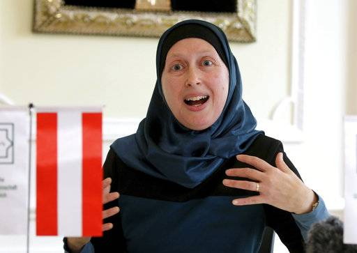 "In this photo taken Wednesday Sept. 27 2017, Carla Amina Baghajati from the Austrian Islamic Religious Community gestures during an interview with The Associated Press in Vienna, Austria. A law prohibiting any kind of full face covering but known popularly as the ""Burqa Ban,� takes effect in Austria Sunday Oct. 1, 2017"