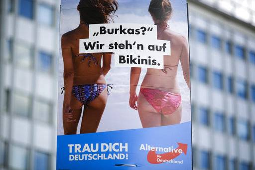 "FILE - In this Aug. 13, 2017 file photo an election campaign poster of the German nationalist anti-migrant party AfD, Alternative for Germany, reading ""Burkas? We like bikinis."" is displayed in  Berlin. The sentence at the bottom reads: 'Trust yourself Germany'. A law prohibiting any kind of full face covering but known popularly as the ""Burqa Ban,� takes effect in Austria Sunday, Oct. 1, 2017."