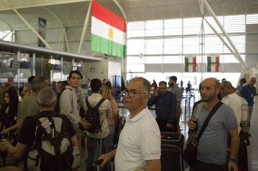 Travelers queue to check in at the Irbil International Airport, in Iraq, Friday, Sept. 29, 2017. Many travelers boarded the last flights out of the cities of Irbil and Sulaymaniyah as an Iraqi government order to halt all international flights in Kurdish territory was set to kick in on Friday.
