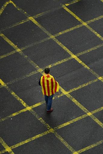 "A pro independence supporter is wrapped in an ""estelada"", or Catalan pro independence flag, during a rally supporting the Catalonia's secession referendum, in Bilbao, northern Spain, Saturday, Sept. 30, 2017. Catalonia's planned referendum on secession is due to be held Sunday by the pro-independence Catalan government but Spain's government calls the vote illegal, since it violates the constitution, and the country's Constitutional Court has ordered it suspended."