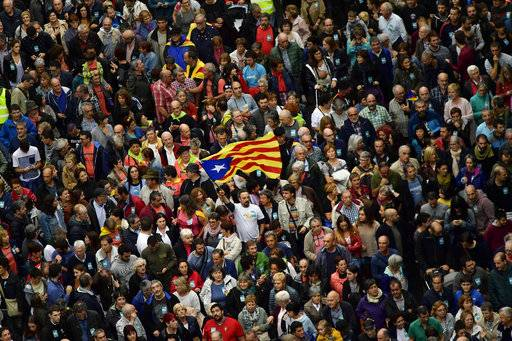 Pro independence supporters take part in a rally in support for the Catalonia's secession referendum, in Bilbao, northern Spain, Saturday, Sept. 30, 2017. Catalonia's planned referendum on secession is due to be held Sunday by the pro-independence Catalan government but Spain's government calls the vote illegal, since it violates the constitution, and the country's Constitutional Court has ordered it suspended.