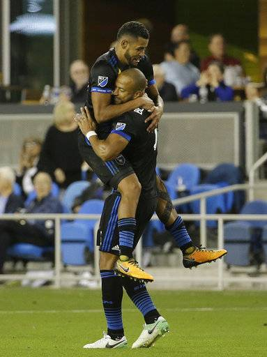 San Jose Earthquakes midfielder Anibal Godoy, left, and defender Victor Bernardez celebrate after the Earthquakes scored against the Portland Timbers during the second half of an MLS soccer match in San Jose, Calif., Saturday, Sept. 30, 2017.
