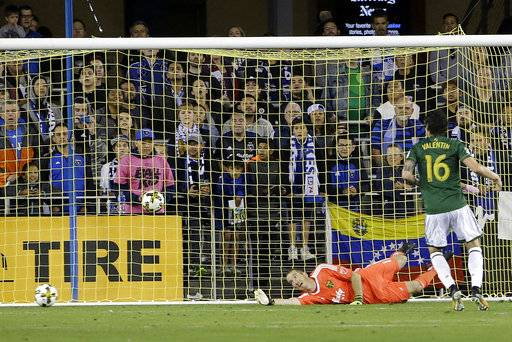 A goal by San Jose Earthquakes forward Danny Hoesen gets past Portland Timbers goalkeeper Jeff Attinella, bottom, during the second half of an MLS soccer match in San Jose, Calif., Saturday, Sept. 30, 2017.