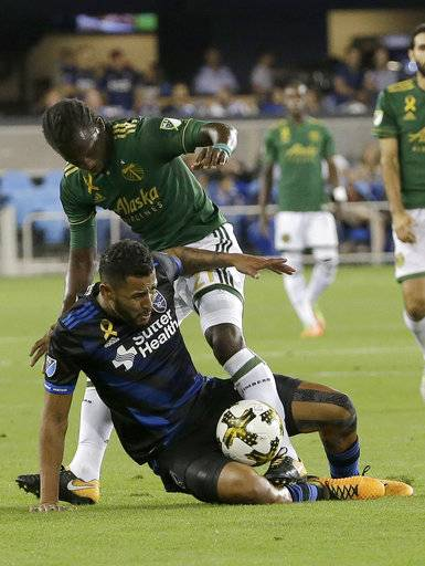 Portland Timbers midfielder Diego Chara, top, tries to get to the ball over San Jose Earthquakes midfielder Anibal Godoy during the first half of an MLS soccer match in San Jose, Calif., Saturday, Sept. 30, 2017.