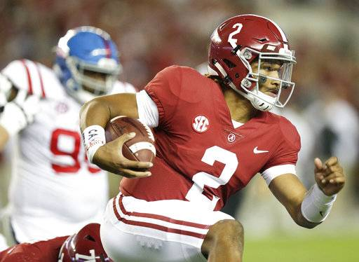 Alabama quarterback Jalen Hurts runs the ball against Mississippi during the first half of an NCAA college football game, Saturday, Sept. 30, 2017, in Tuscaloosa, Ala.