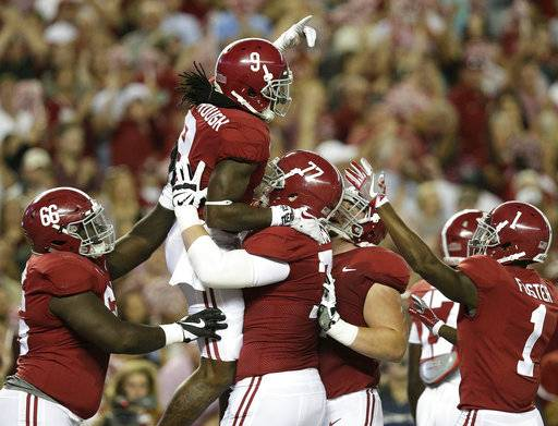 Alabama running back Bo Scarbrough celebrates with teammates after scoring a touchdown during the first half of an NCAA college football game against Mississippi, Saturday, Sept. 30, 2017, in Tuscaloosa, Ala.