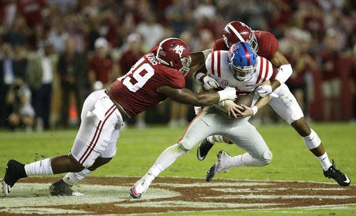 Mississippi quarterback Shea Patterson is sacked by Alabama defensive back Minkah Fitzpatrick, right, and Alabama defensive lineman Isaiah Buggs, left, during the first half of an NCAA college football game, Saturday, Sept. 30, 2017, in Tuscaloosa, Ala.