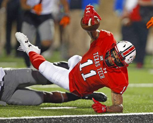 Texas Tech's Derrick Willies (11) falls short of the goal line during an NCAA college football game against Oklahoma State, Saturday, Sept. 30, 2017, in Lubbock, Texas. (Brad Tollefson/Lubbock Avalanche-Journal via AP)