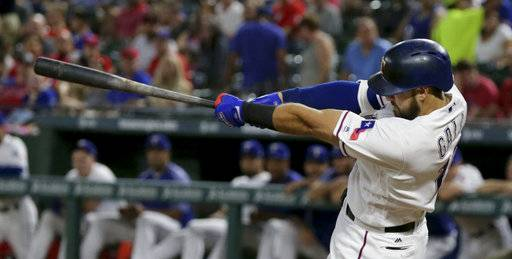 Texas Rangers Joey Gallo swings though a home run during the second inning of a baseball game against the Oakland Athletics in Arlington, Texas, Saturday, Sept. 30, 2017.