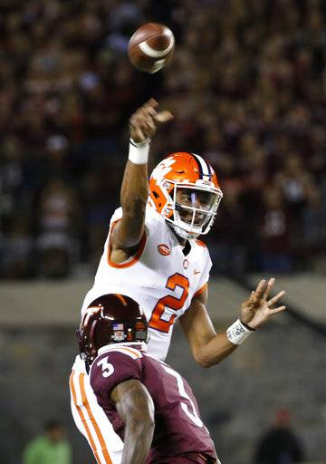 Clemson quarterback Kelly Bryant (2) tosses a pass as Virginia Tech cornerback Greg Stroman (3) closes in during the first half of an NCAA college football game in Blacksburg, Va., Saturday, Sept. 30, 2017.