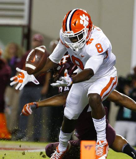 Clemson wide receiver Deon Cain (8) reaches for a pass int he end zone as Virginia Tech linebacker Anthony Shegog (24) defends during the first half of an NCAA college football game in Blacksburg, Va., Saturday, Sept. 30, 2017. Cain missed the pass.