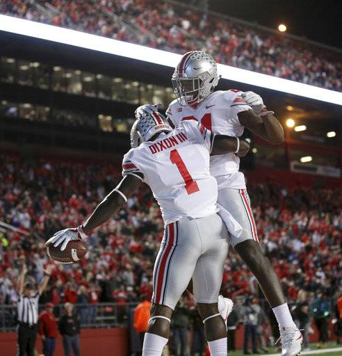 Ohio State wide receiver Johnnie Dixon (1) celebrates a touchdown with teammate Parris Campbell during the first half of an NCAA college football game against Rutgers, Saturday, Sept. 30, 2017, in Piscataway, N.J.