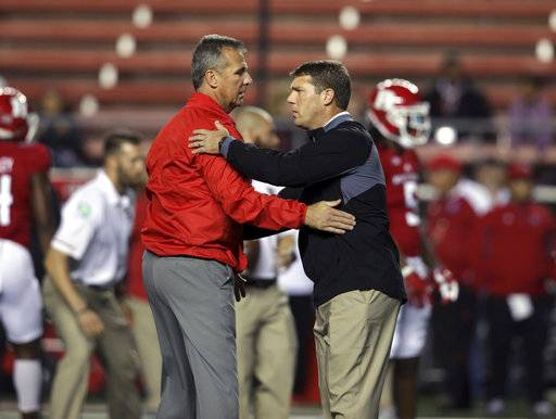 Ohio State head coach Urban Meyer, left, greets Rutgers head coach Chris Ash before an NCAA college football game Saturday, Sept. 30, 2017, in Piscataway, N.J.