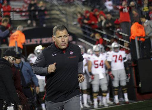 Former Rutgers football head coach, now Ohio State associate head coach/defensive coordinator, Greg Schiano runs onto the field before an NCAA college football game against Rutgers, Saturday, Sept. 30, 2017, in Piscataway, N.J.