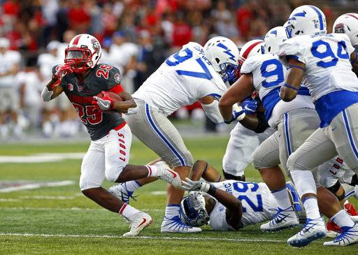 New Mexico running back Tyrone Owens (25) gets past the Air Force defense during the first half of an NCAA college football game in Albuquerque, N.M., Saturday, Sep. 30, 2017.