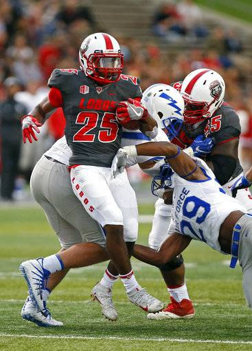 New Mexico running back Tyrone Owens (25) breaks a tackle by Air Force defensive back Kyle Floyd (29) during the first half of an NCAA college football game in Albuquerque, N.M., Saturday, Sep. 30, 2017.