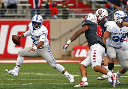 Air Force quarterback Arion Worthman (2) tries to get away from the New Mexico defense during the first half of an NCAA college football game in Albuquerque, N.M., Saturday, Sep. 30, 2017.