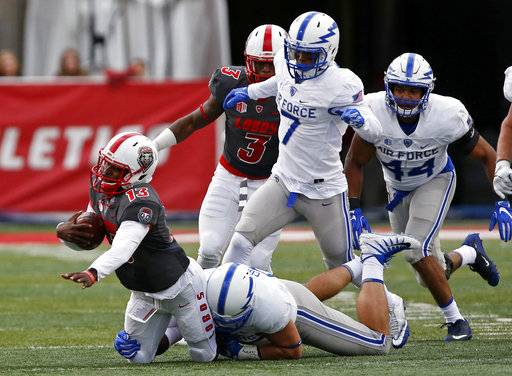 New Mexico quarterback Lamar Jordan (13) is sacked by Air Force defensive lineman Santo Coppola during the first half of an NCAA college football game in Albuquerque, N.M., Saturday, Sep. 30, 2017.