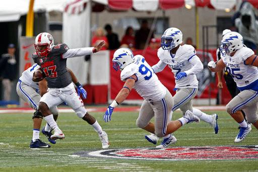 New Mexico quarterback Lamar Jordan (13) runs for yardage past the Air Force defense during the first half of an NCAA college football game in Albuquerque, N.M., Saturday, Sep. 30, 2017.