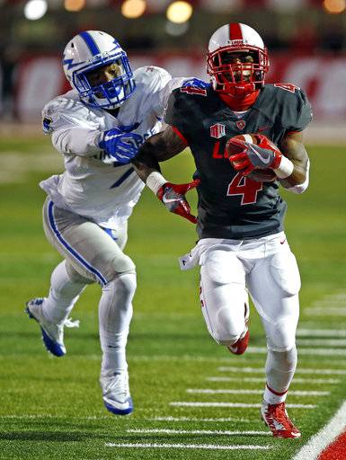 New Mexico running back Romell Jordan (4) sprints to the end zone past Air Force linebacker Ja'Mel Sanders (7) during the second half of an NCAA college football game in Albuquerque, N.M., Saturday, Sept. 30, 2017. New Mexico won 56-38.