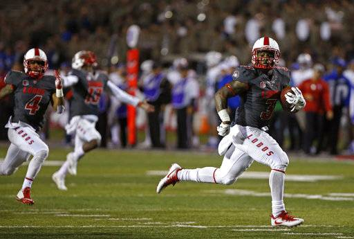 New Mexico running back Richard McQuarley (3) sprints to the end zone to score one of his five touchdowns of the NCAA college football game against Air Force in Albuquerque, N.M., Saturday, Sep. 30, 2017. New Mexico won 56-38.