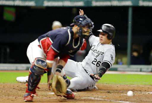 CORRECTS TO SIXTH INNING NOT FIFTH INNING - Chicago White Sox's Avisail Garcia (26) scores as Cleveland Indians catcher Yan Gomes waits for the ball in the sixth inning of a baseball game, Saturday, Sept. 30, 2017, in Cleveland. Garcia scored on a one-run double hit by Kevan Smith.