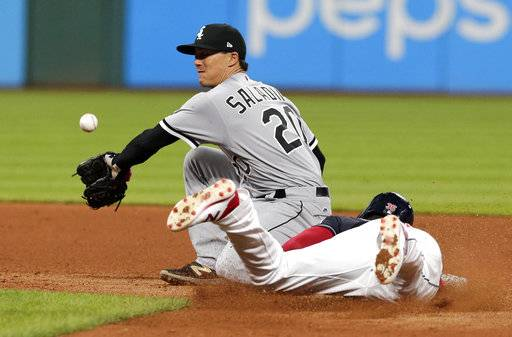 Chicago White Sox's Tyler Saladino, left, cannot hold onto the ball as Cleveland Indians' Abraham Almonte slides safely into second base on a steal in the seventh inning of a baseball game, Saturday, Sept. 30, 2017, in Cleveland.