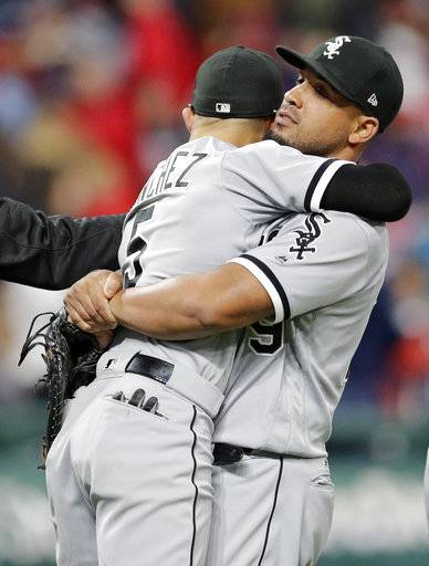 Chicago White Sox's Jose Abreu, right, lifts up and hugs Yolmer Sanchez after theydefeated the Cleveland Indians in a baseball game, Saturday, Sept. 30, 2017, in Cleveland.
