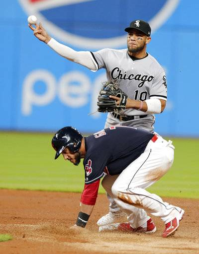 Chicago White Sox's Yoan Moncada, top, gets Cleveland Indians' Yan Gomes, bottom, out at second base and throws to first base in the third inning of a baseball game, Saturday, Sept. 30, 2017, in Cleveland. Giovanny Urshela was out at first base for the double play.