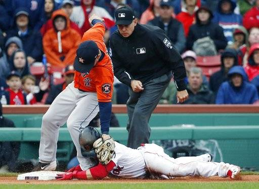 Houston Astros' Alex Bregman, left, puts on the late tag as Boston Red Sox's Andrew Benintendi steals third base during the fifth inning of a baseball game in Boston, Saturday, Sept. 30, 2017.