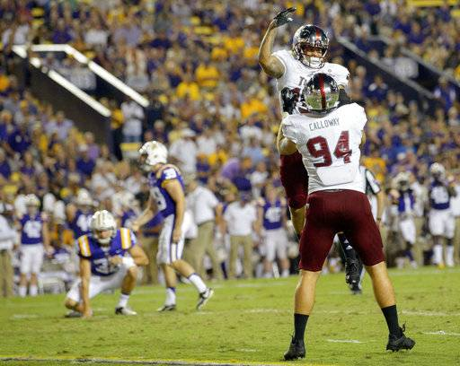 Troy wide receiver Damion Willis (15) and defensive end Seth Calloway (94) celebrate a missed field goal by LSU place kicker Jack Gonsoulin (39) in the first half of an NCAA college football game in Baton Rouge, La., Saturday, Sept. 30, 2017.