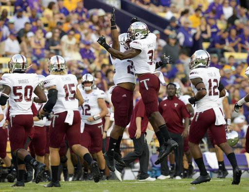 Troy linebacker A.J. Smiley (31) celebrates a defensive play on fourth down making LSU turnover on downs in the first half of an NCAA college football game in Baton Rouge, La., Saturday, Sept. 30, 2017.