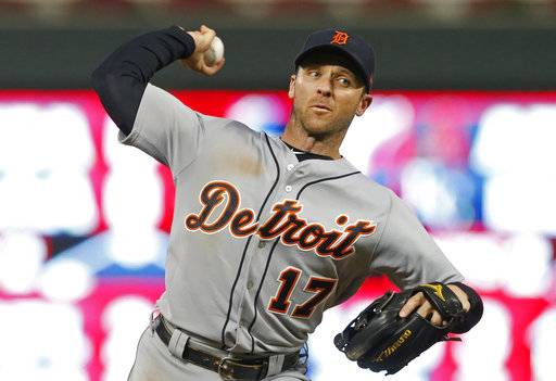 Detroit Tigers' Andrew Romine pitches against the Minnesota Twins during the eighth inning of a baseball game Saturday, Sept. 30, 2017, in Minneapolis. Romine joined a select few players by playing in all nine positions during the game. The Tigers won 3-2.
