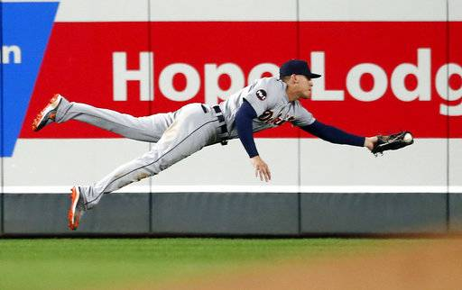 Detroit Tigers center fielder JaCoby Jones makes a diving try but can't pull in the ball for a hit by Minnesota Twins' Ehire Adrianza in the seventh inning of a baseball game Saturday, Sept. 30, 2017, in Minneapolis.