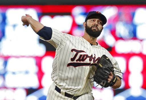 Minnesota Twins pitcher Dillon Gee throws in relief against the Detroit Tigers during the fifth inning of a baseball game Saturday, Sept. 30, 2017, in Minneapolis.
