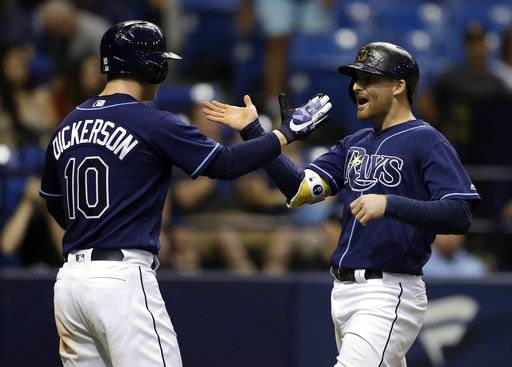 Tampa Bay Rays' Brad Miller, right, celebrates with Corey Dickerson after Miller hit a three-run home run off Baltimore Orioles pitcher Miguel Castro during the fourth inning of a baseball game Saturday, Sept. 30, 2017, in St. Petersburg, Fla.
