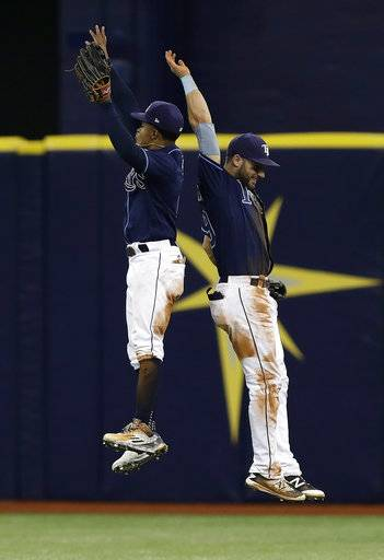 Tampa Bay Rays' Mallex Smith, left, and Kevin Kiermaier celebrate after the Rays defeated the Baltimore Orioles 4-3 during a baseball game Saturday, Sept. 30, 2017, in St. Petersburg, Fla.