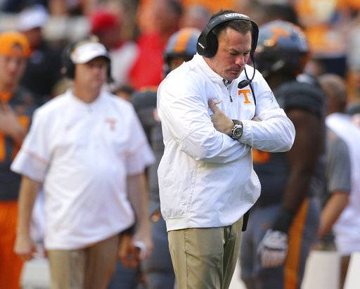 Tennessee head coach Butch Jones walks the sidelines in the final minutes of a 41-0 loss to Georgia in an NCAA college football game against Tennessee on Saturday, Sept. 30, 2017, in Knoxville, Tenn. (Curtis Compton/Atlanta Journal-Constitution via AP)