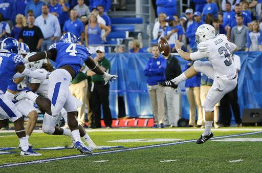 Kentucky linebacker Joshua Paschal blocks a punt by Eastern Michigan punter Jake Julien which turned the ball over to Kentucky leading to a touchdown during the second half of an NCAA college football game Saturday, Sept. 30, 2017, in Lexington, Ky. Kentucky won the game 24-20.