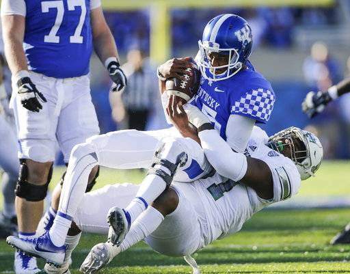 Eastern Michigan defensive lineman Kwanii Figueroa sacks Kentucky quarterback Stephen Johnson for a loss of yards during the first half of an NCAA college football game Saturday, Sept. 30, 2017, in Lexington, Ky.