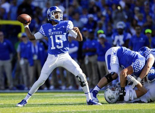 Kentucky quarterback Stephen Johnson throws a first down pass during the first half of an NCAA college football game against Eastern Michigan, Saturday, Sept. 30, 2017, in Lexington, Ky.