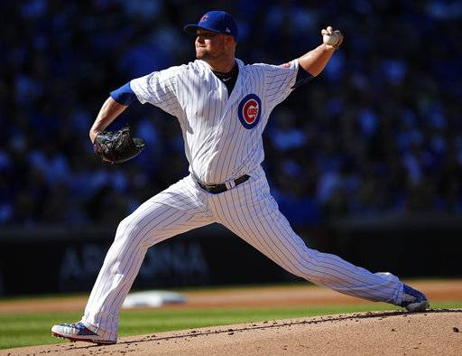 Chicago Cubs' Jon Lester pitches against the Cincinnati Reds during the first inning of a baseball game Saturday, Sept. 30, 2017, in Chicago.