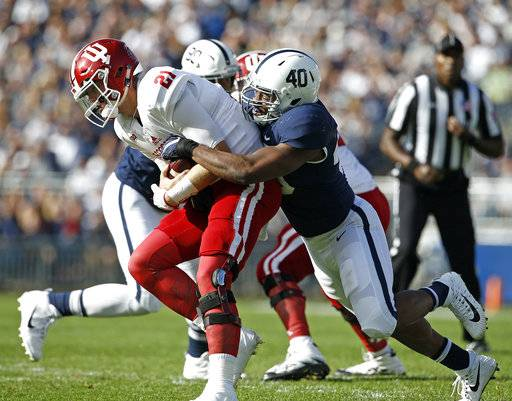 Penn State's Jason Cabinda (40) sacks Indiana quarterback Richard Lagow (21) during the first half of an NCAA college football game in State College, Pa., Saturday, Sept. 30, 2017.