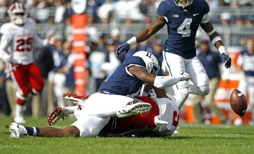 Penn State's Irvin Charles (11) causes Indiana's J-Shun Harris (5) to fumble a punt return that was picked up by Penn State during the first half of an NCAA college football game in State College, Pa., Saturday, Sept. 30, 2017.