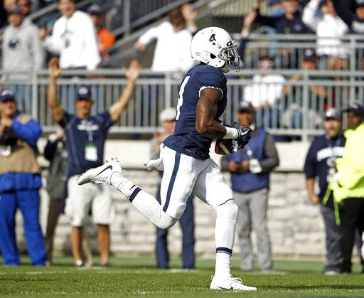 Penn State's Nick Scott (4) picks up a fumbled punt return by Indiana's J-Shun Harris (5) and takes it in for a touchdown during the first half of an NCAA college football game in State College, Pa., Saturday, Sept. 30, 2017.