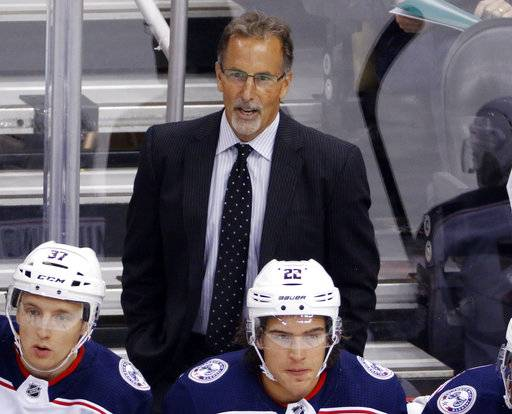 Columbus Blue Jackets' John Tortorella stands behind his bench during the first period of a NHL preseason hockey game against the Pittsburgh Penguins in Pittsburgh, Saturday, Sept. 30, 2017.