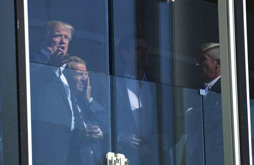 President Donald Trump watches the Presidents Cup golf tournament at the Liberty National Golf Course in Jersey City, N.J., Sunday, Oct. 1, 2017. The President of the United States is the Honorary Presidents Cup Chairman.