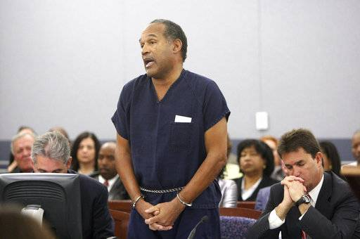 "FILE - In this Dec. 5, 2008, file photo, O.J. Simpson speaks during his sentencing hearing at the Clark County Regional Justice Center in Las Vegas. Sitting right to Simpson is his lawyer Yale Galanter. Simpson was sentenced Friday to at least 15 years in prison for a hotel armed robbery after a judge rejected his apology and said, ""It was much more than stupidity."" A Nevada prison official said early Sunday, Oct. 1, 2017, O.J. Simpson, the former football legend and Hollywood star, has been released from a Nevada prison in Lovelock after serving nine years for armed robbery."